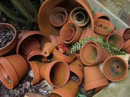 Old pots in the flower bed..